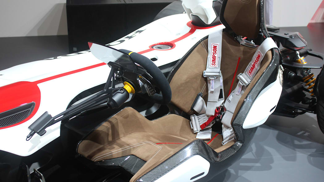 Honda Project 2 & 4 concept that combines the company's RC-213vs MotoGP bike with a car, at the 2015 Frankfurt Motor Show, free-hanging seat.
