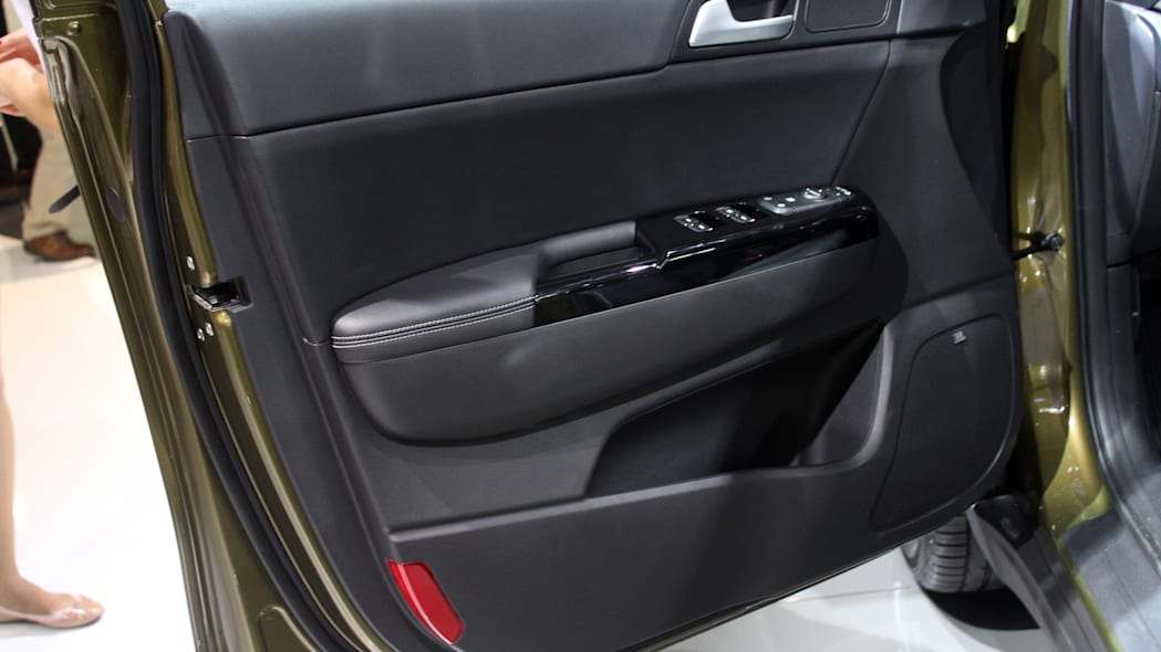 The 2016 Kia Sportage, revealed at the 2015 Frankfurt Motor Show, driver's door panel.