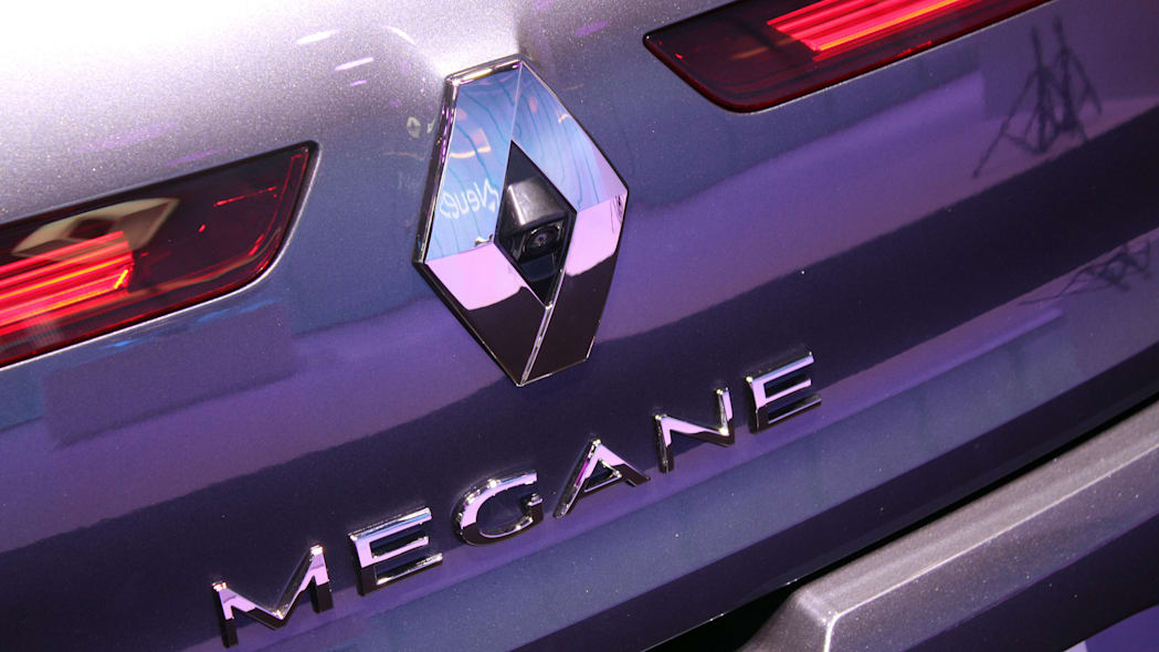 The 2016 Renault Megane, introduced at the 2015 Frankfurt Motor Show, close-up of the badge and rearview camera on the tailgate.