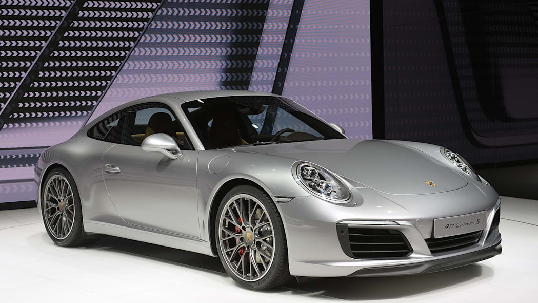 The 2016 Porsche 911 Carrera, now with a turbocharged engine in the standard car, unveiled at the Frankfurt Motor Show, front three-quarter view.