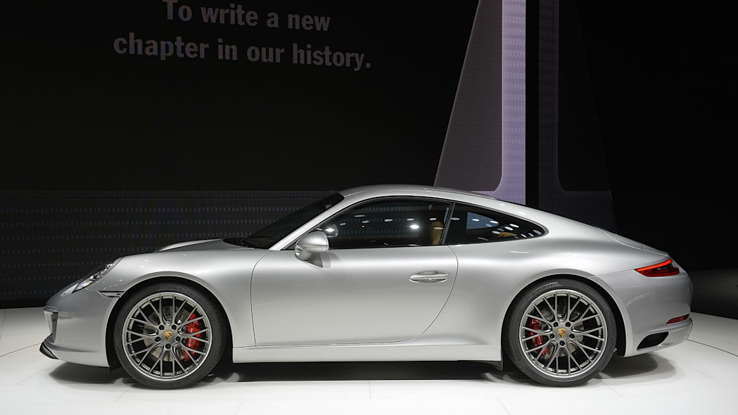 The 2016 Porsche 911 Carrera, now with a turbocharged engine in the standard car, unveiled at the Frankfurt Motor Show, side view.