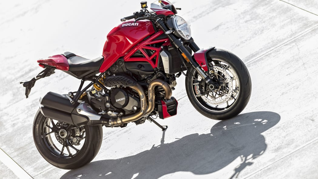 red ducati monster 1200 r on concrete