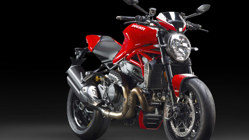 red ducati monster 1200 r front three quarters black background