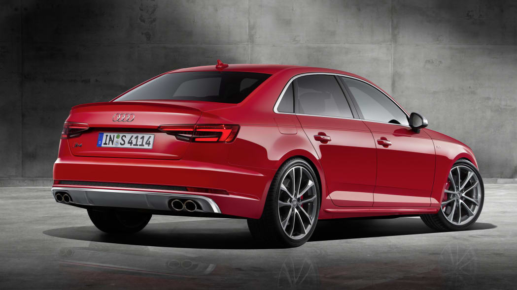 red 2017 audi s4 rear three quarters concrete