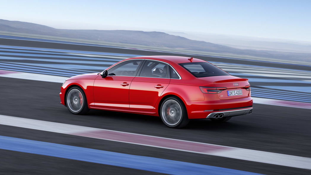 red 2017 audi s4 rear three quarters track