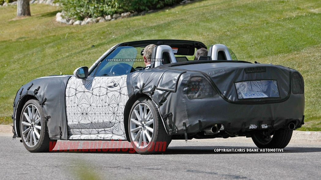 camouflaged fiat 124 spy shots rear three quarters