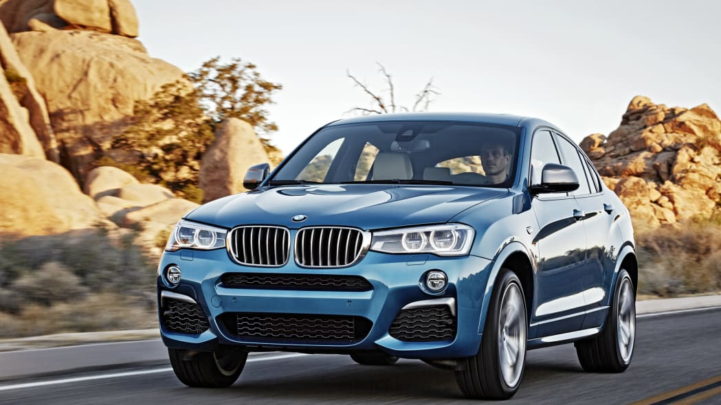 BMW X4 M40i front 3/4 rolling sunset