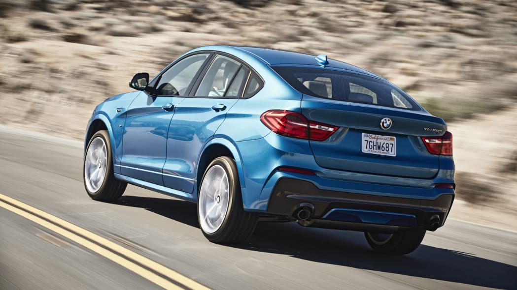 BMW X4 M40i rear 3/4 view driving
