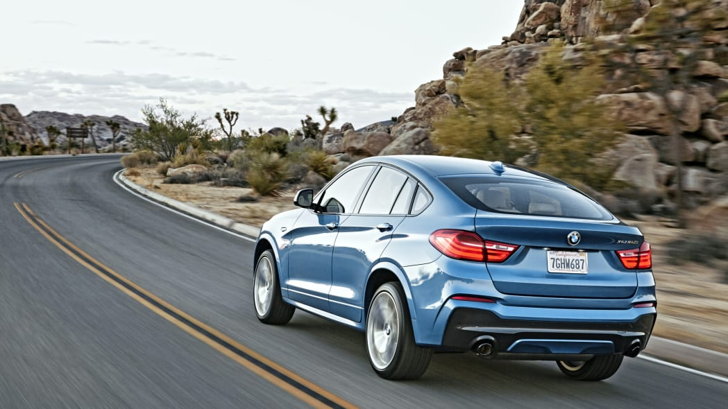 BMW X4 M40i rear 3/4 view moving