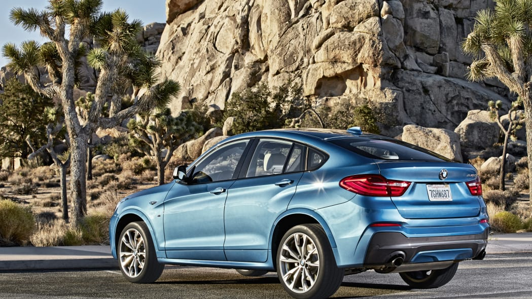 BMW X4 M40i rear 3/4 static road parked