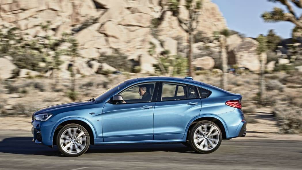 BMW X4 M40i front 3/4 moving road location
