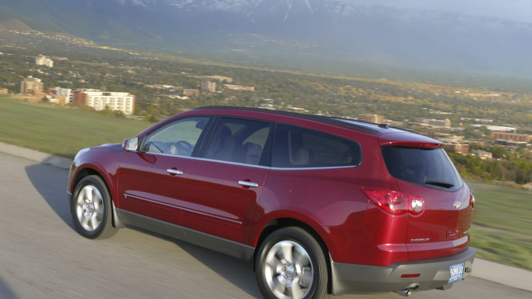 2011 Chevy Traverse red rear driving