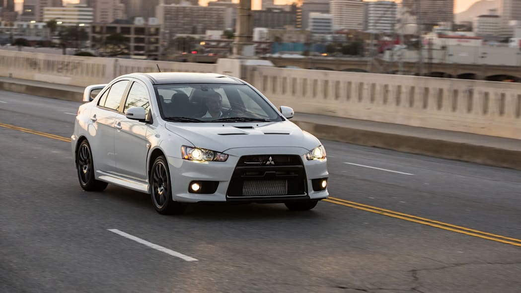 The 2015 Mitsubishi Lancer Evolution Final Edition, dynamic front three-quarter view.