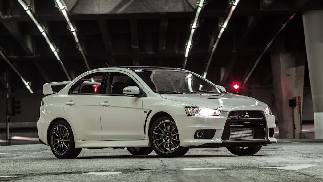 The 2015 Mitsubishi Lancer Evolution Final Edition, nighttime shot, front three-quarter.