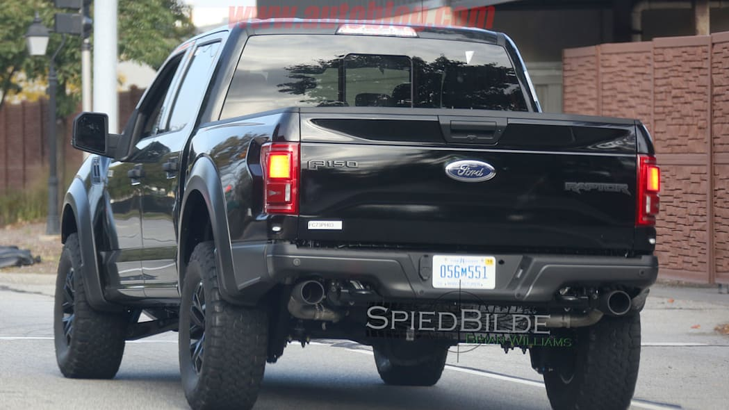 black 2017 ford f-150 raptor spy shot crew cab profile rear with exhaust