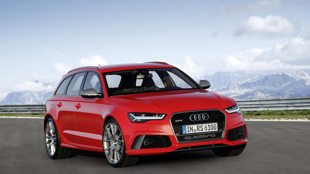 red audi rs6 avant performance front three quarters mountains