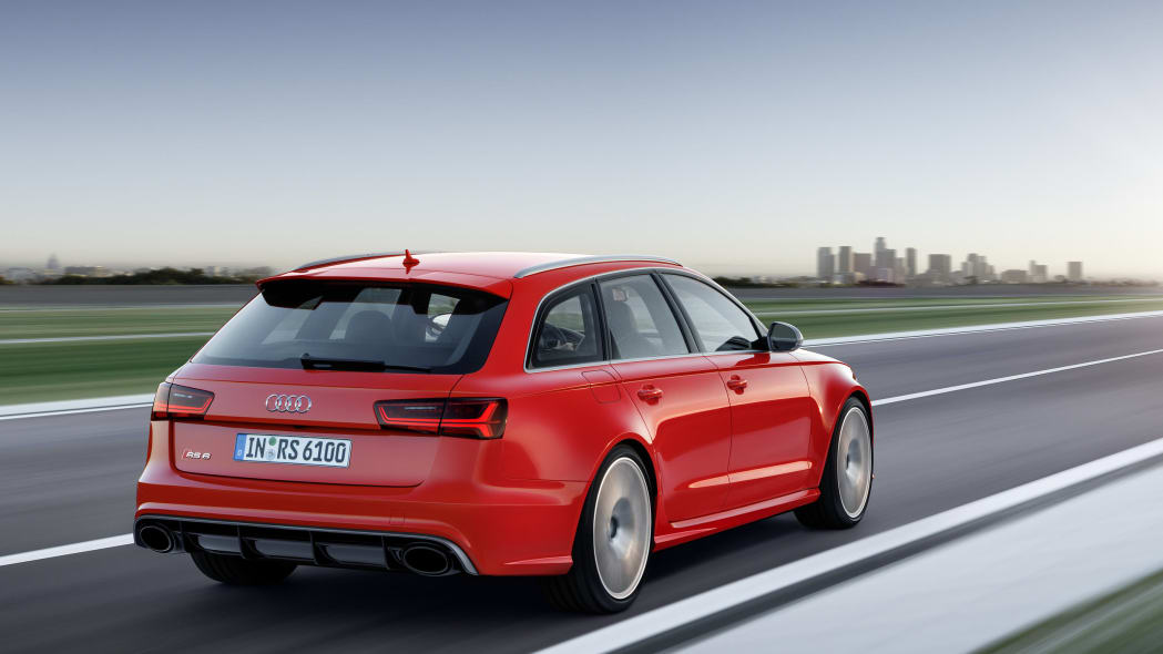 red audi rs6 avant performance rear three quarters city