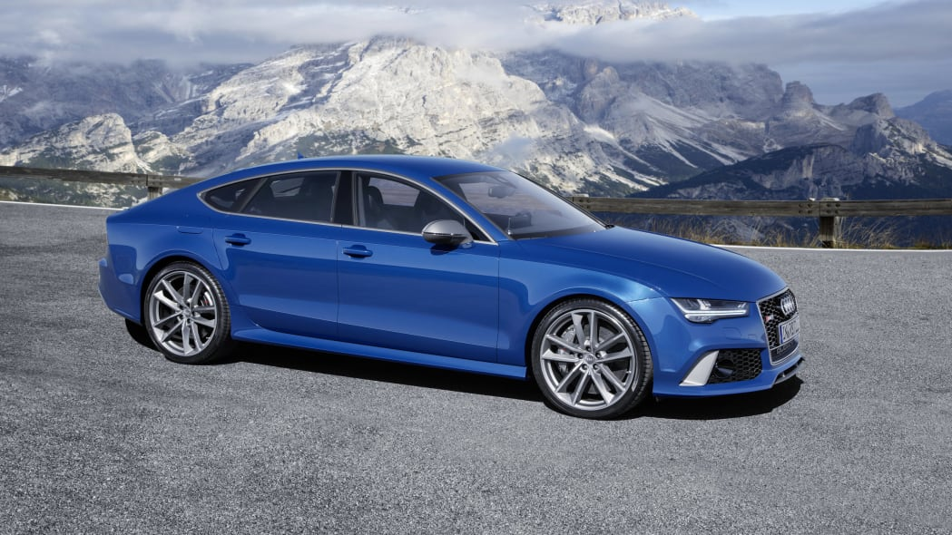 blue audi rs7 sportback performance in the mountains