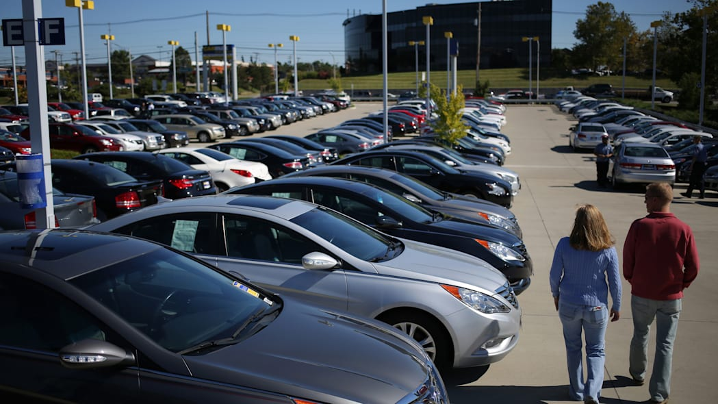 Used car lot and shoppers
