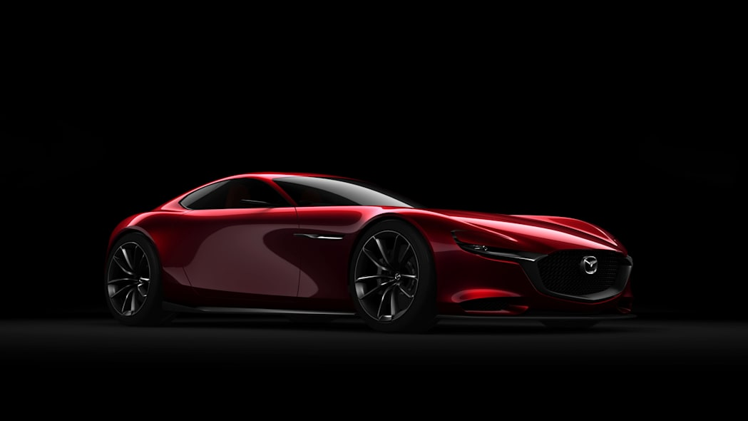 red mazda rx-vision concept three quarters black background