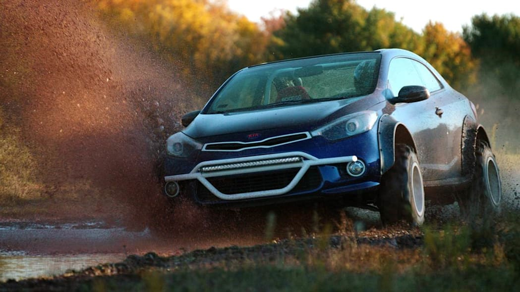 Kia Forte Koup Mud Bogger Concept driving mud off-road