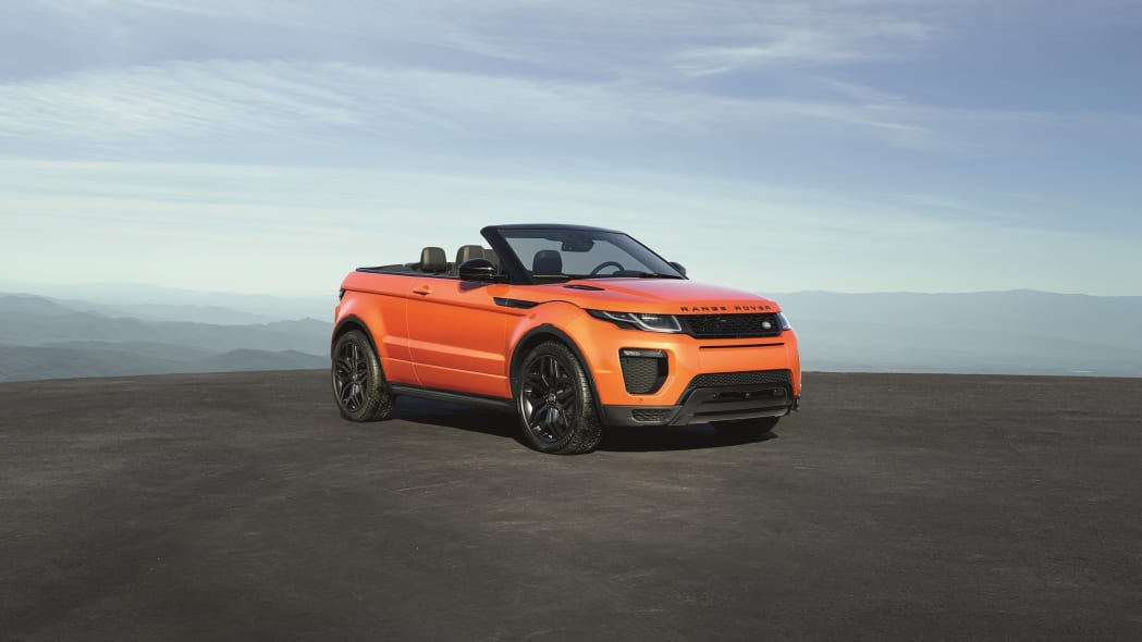 The 2017 Range Rover Evoque Convertible, front three-quarter low, top down.