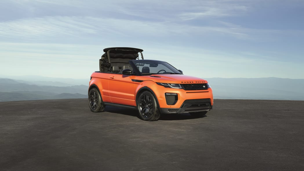 The 2017 Range Rover Evoque Convertible, front three-quarter view, top raising.