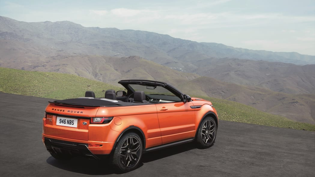 The 2017 Range Rover Evoque Convertible, rear three-quarter view, top down.