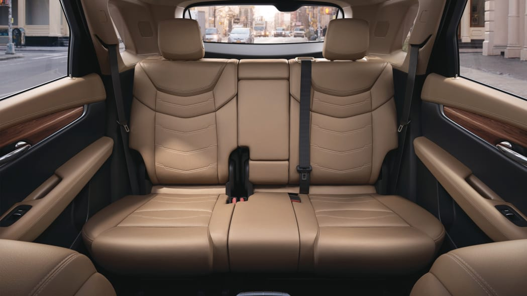backseat cadillac xt5 cabin interior leather wood