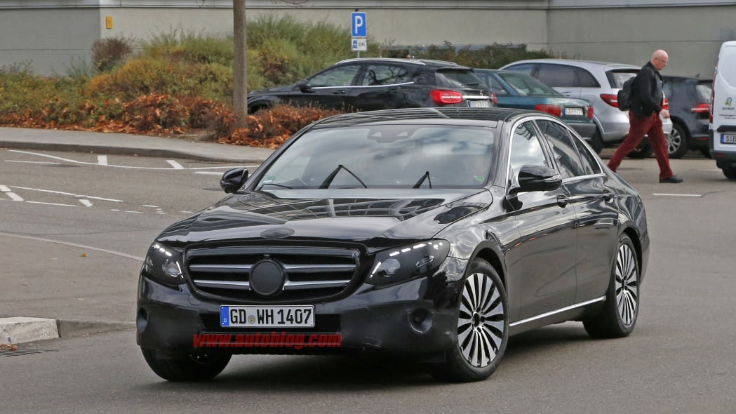 The 2017 Mercedes-Benz E-Class, front three-quarter view with camouflage.