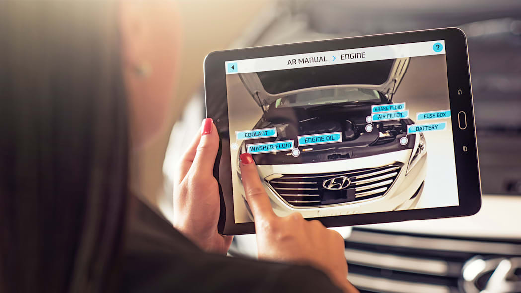 A demonstration of the Hyundai Virtual Guide, an app that uses augmented reality to display content of the owner's manual, on an iPad.