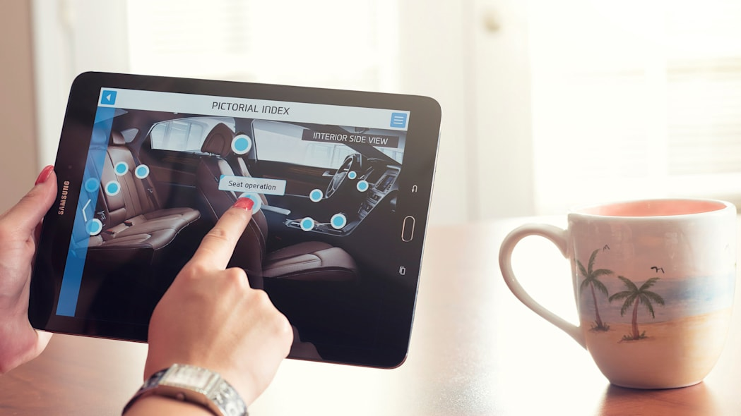 A demonstration of the Hyundai Virtual Guide, an app that uses augmented reality to display content of the owner's manual, viewing the interior.