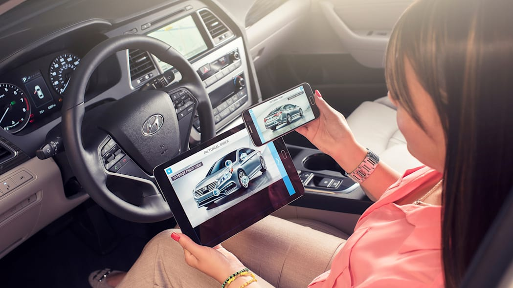 A demonstration of the Hyundai Virtual Guide, an app that uses augmented reality to display content of the owner's manual, on an iPad and a smartphone.