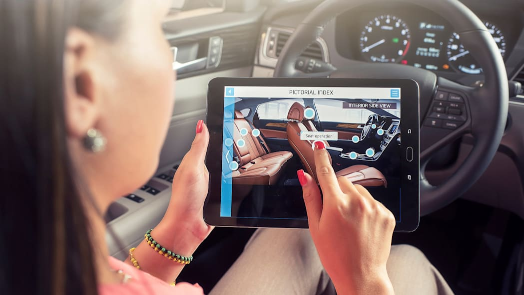 A demonstration of the Hyundai Virtual Guide, an app that uses augmented reality to display content of the owner's manual, viewing seat operation.