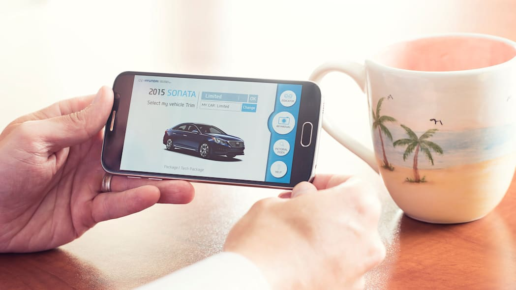 A demonstration of the Hyundai Virtual Guide, an app that uses augmented reality to display content of the owner's manual, choosing the trim.