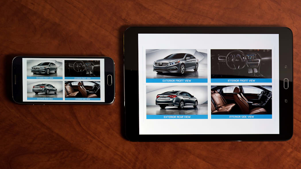 A demonstration of the Hyundai Virtual Guide, an app that uses augmented reality to display content of the owner's manual, seen on a smartphone and a tablet.