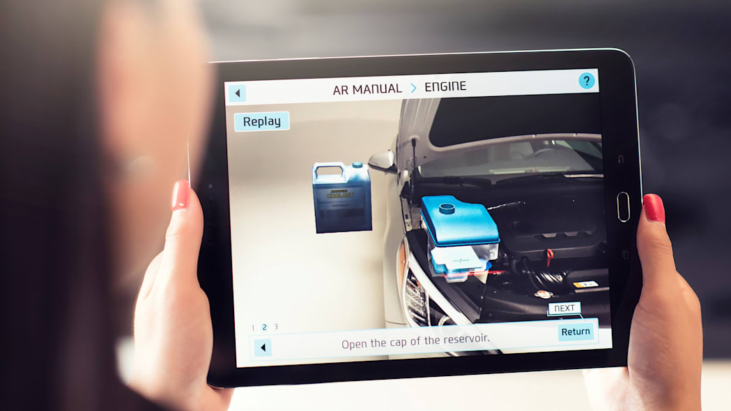 A demonstration of the Hyundai Virtual Guide, an app that uses augmented reality to display content of the owner's manual, on a tablet.