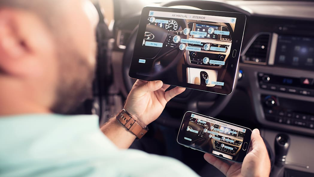 A demonstration of the Hyundai Virtual Guide, an app that uses augmented reality to display content of the owner's manual, viewing the center console options.