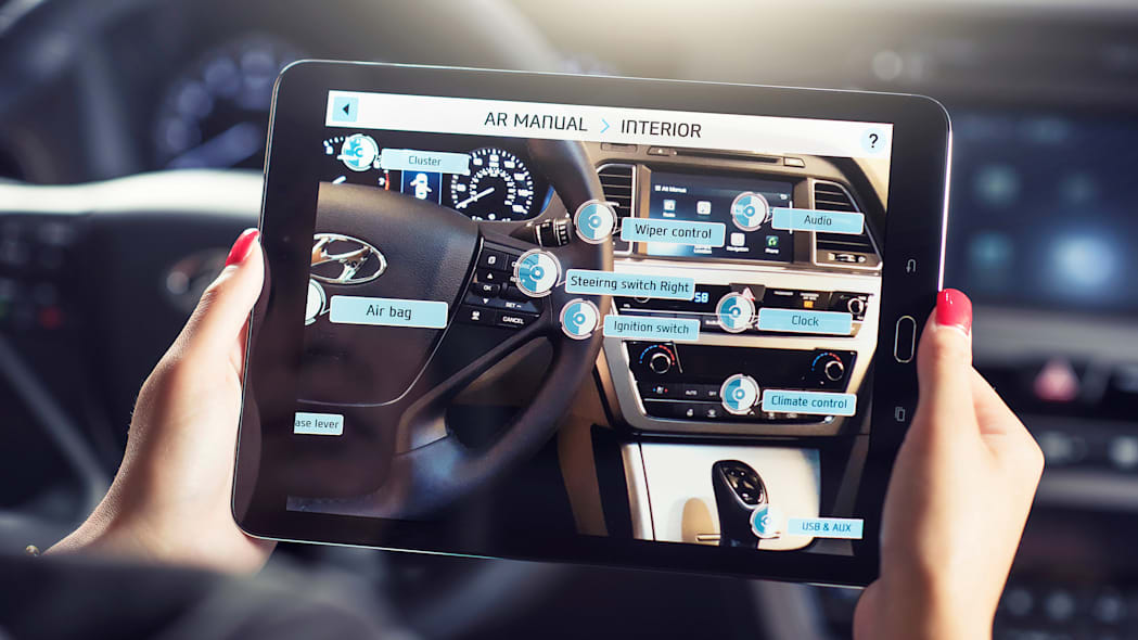 A demonstration of the Hyundai Virtual Guide, an app that uses augmented reality to display content of the owner's manual, on a tablet, the center console options.