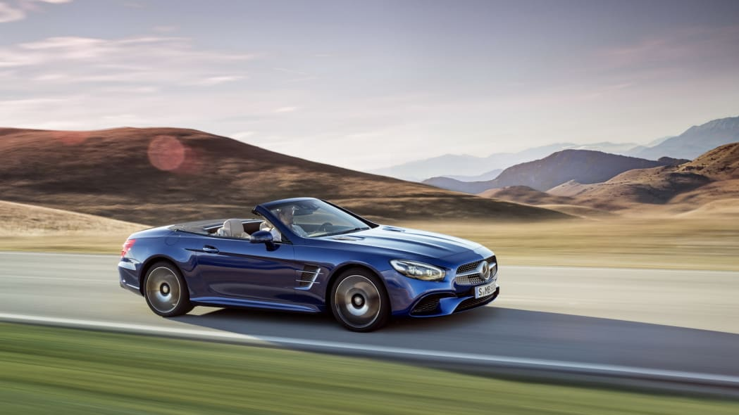 blue 2017 mercedes sl side mountains