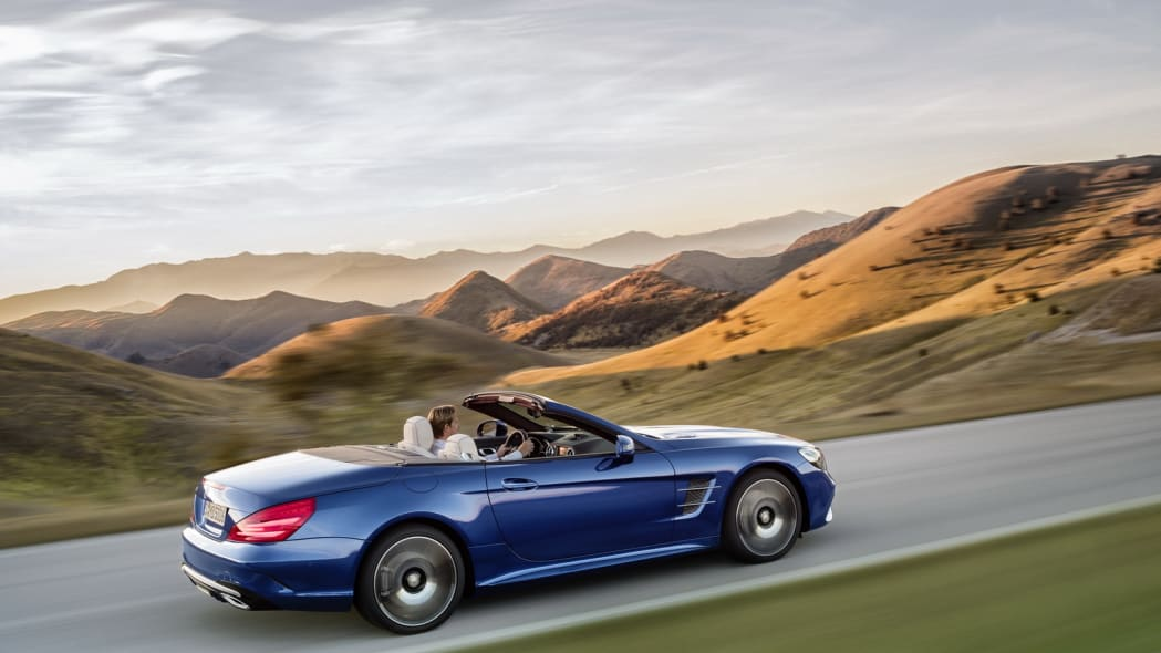 blue 2017 mercedes sl rear mountains