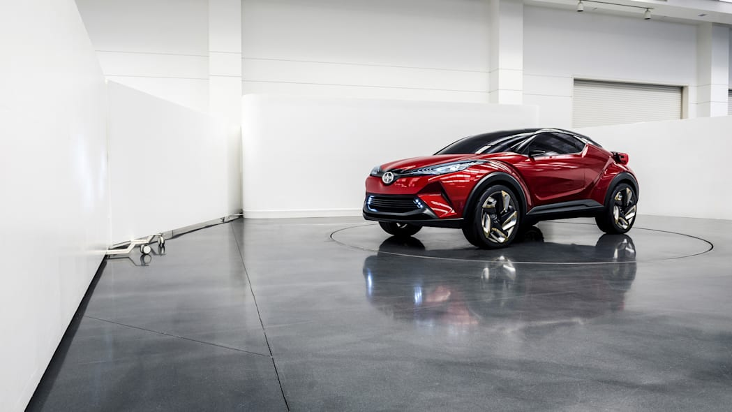 The Scion C-HR concept shown off in red for the LA Auto Show, indoor front three-quarter.