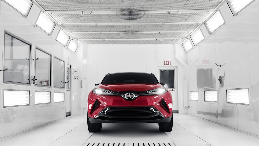 The Scion C-HR concept shown off in red for the LA Auto Show, front view indoors.
