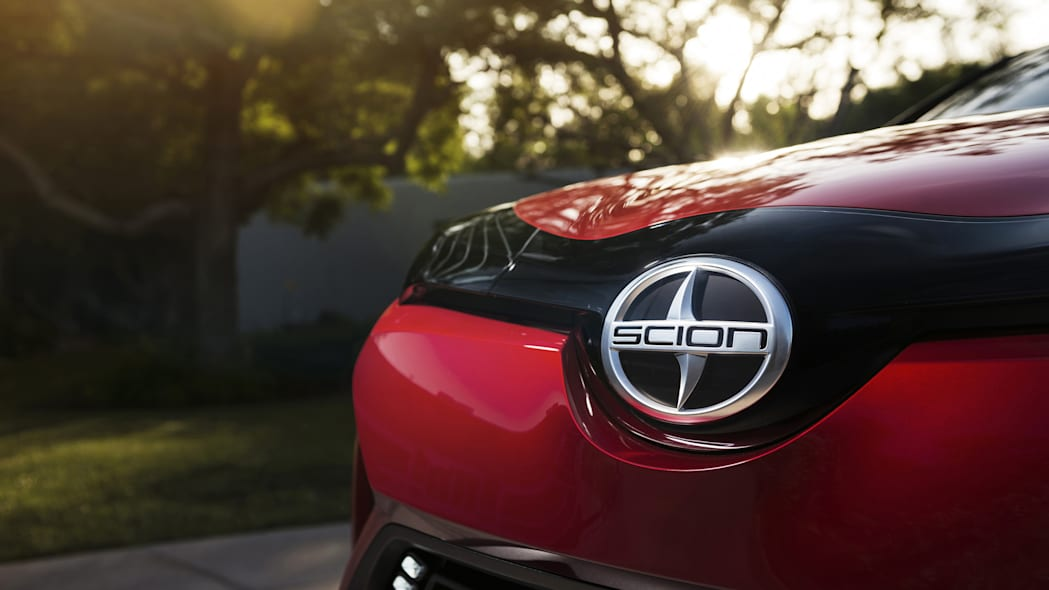 The Scion C-HR concept shown off in red for the LA Auto Show, detail of the hood badge.