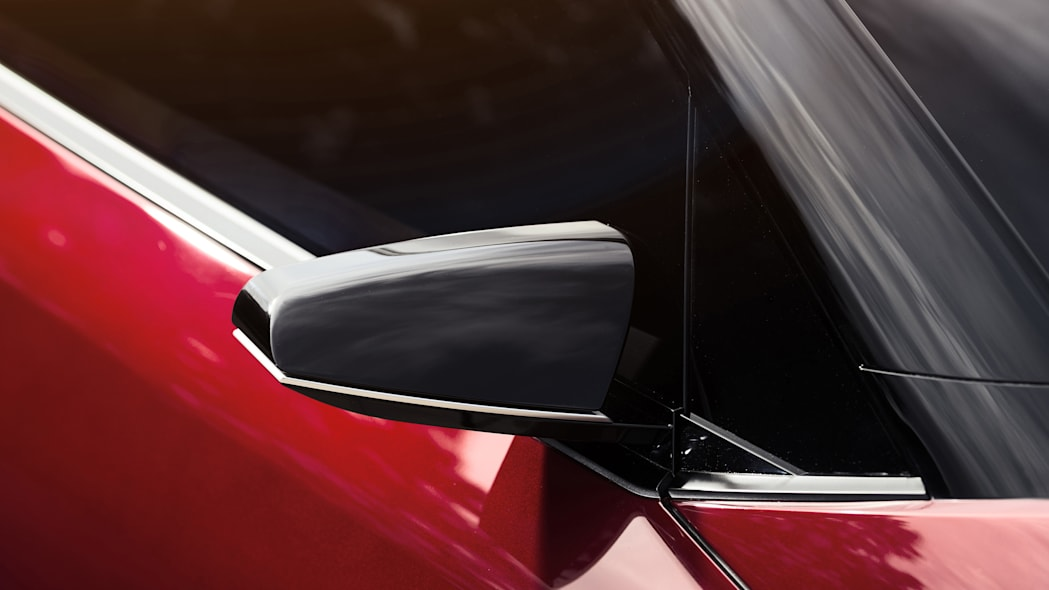 The Scion C-HR concept shown off in red for the LA Auto Show, side mirror detail.