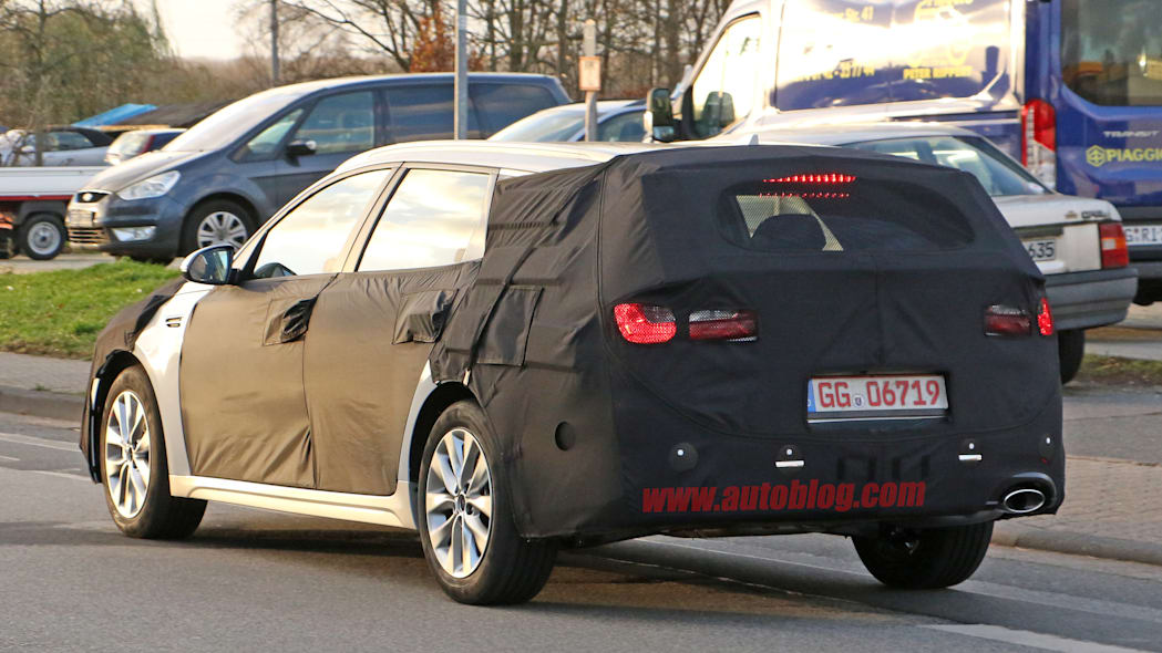 Kia Sportswagon prototype caught by spy photographers, rear three-quarter showing tailpipe.