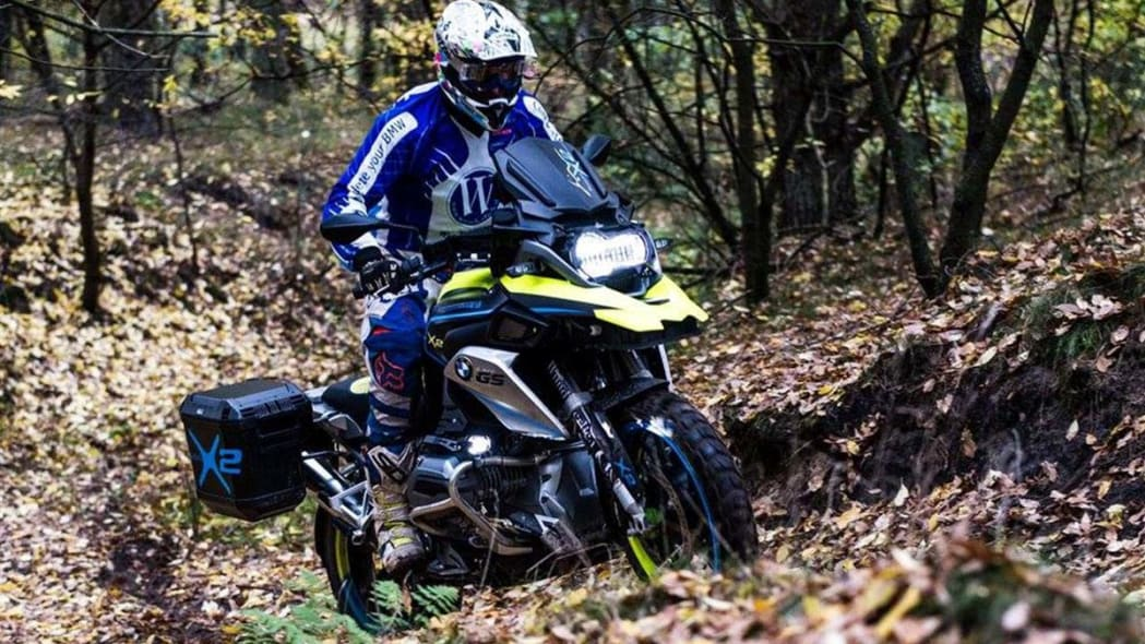 The two-wheel drive Wunderlich BMW R1200 GS LC, which uses a 10kW hub motor up front and a battery pack under the beak, going up a hill.