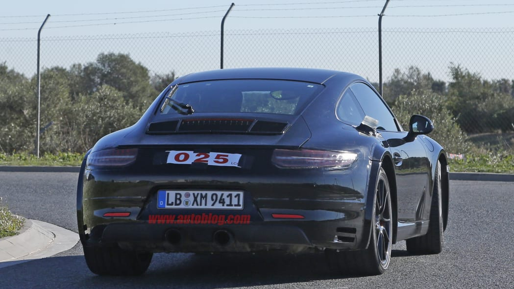 Spy shot of the next-generation 992-model Porsche 911 thought to hide a hybrid powertrain, rear.