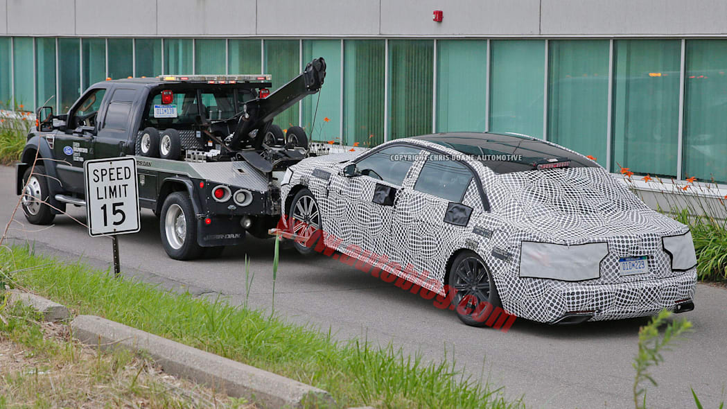 camouflage lincoln continental spy photo tow truck