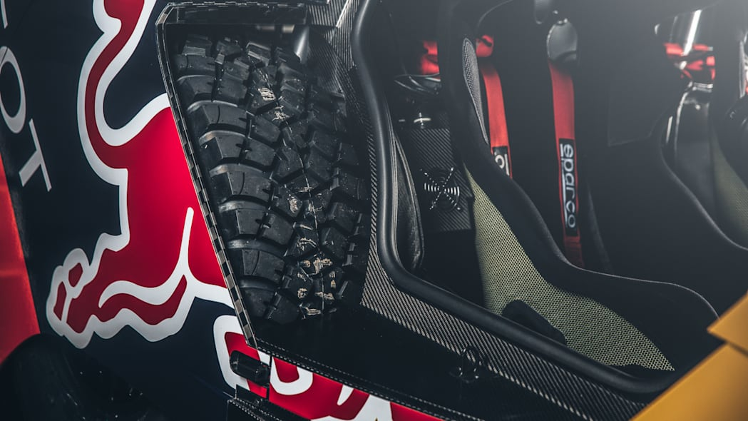 The Peugeot 2008 DKR for the 2016 Dakar Rally, rear wheel and interior.